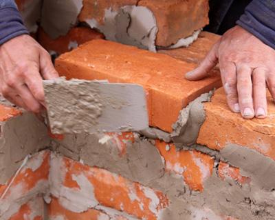 costruire muro